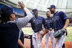 July 8, 2017 - St. Petersburg, Florida, U.S. - WILL VRAGOVIC   |   Times.Tampa Bay Rays shortstop Adeiny Hechavarria (11) greeted in the dugout by starting pitcher Chris Archer (22) after his play on the liner by Boston Red Sox catcher Sandy Leon (3) to end the top of the fifth inning of the game between the Boston Red Sox and the Tampa Bay Rays at Tropicana Field in St. Petersburg, Fla. on Saturday, July 8, 2017. (Credit Image: © Will Vragovic/Tampa Bay Times via ZUMA Wire)