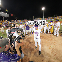 "09 June 2008:  LSU Head Coach Paul Mainieri #1 holds up a ""Omaha Bound"" sign after his team's 21-7 victory over the UC Irvine Anteaters in game three of the NCAA Baseball Baton Rouge Super Regional Alex Box Stadium in Baton Rouge, LA. The LSU Tigers with the win advance to the College Baseball World Series in Omaha, Nebraska.."