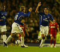Photo: Aidan Ellis.<br /> Everton v Dinamo Bucuresti. UEFA Cup. 29/09/2005.<br /> Everton's Tim Cahill celebrates his goal with Phil Neville