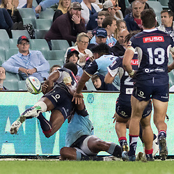 Marika Koroibete of the Melbourne Rebels is bundled into touch during the super rugby match between Waratahs and the Rebels Allianz Stadium 21 May 2017(Photo by Mario Facchini -Steve Haag Sports)