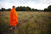 Local Buddhist monks walk through the countryside in the Areng Valley which is at risk of being flooded by the 108 megawatt Cheay Areng Dam. The project will wipe out the world's largest remaining wild population of Siamese crocodiles. The dam will destroy more than 10.000 hectares of the Central Cardamom Protected Forest (CCPF), which is critical habitat for 31 endangered animal species including the Asian Elephant and the Arowana or Dragon Fish. Access roads and electricity transmission lines for the dam will cut through the CCPF and nearby forests, increasing access for illegal loggers and poachers. Large, connected and ecologically intact old-growth forests such as found in the CCPF are critical for local and global ecological sustainability and well-being...The dam will flood nine Khmer Daeum villages and their ancestral farmlands and 'spirit forests' and forcibly displace more than 900 villagers. These people will be forcibly relocated to a known elephant migration route and have yet to be adequately consulted about the project. The project's economic feasibility is also highly questionable, due to its high costs and limited dry-season output. Investing in more sustainable alternative energy options would better meet Cambodia's energy needs, while protecting the Areng Valley..