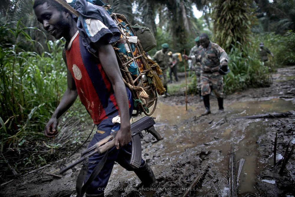 FDLR soldiers trek to their jungle camp in North Kivu, DRC, on Sunday, March. 16, 2008..The FDLR comprises Hutu extremists who fled Rwanda after their involvement in the 1994 genocide, as well as Hutu members of the former Rwandan army and a mix of displaced Rwandan Hutus. Numbering approximately 10,000, they have lived in the jungles of DRC for the past 14 years and in that time have resisted repeated calls for disarmament and repatriation..