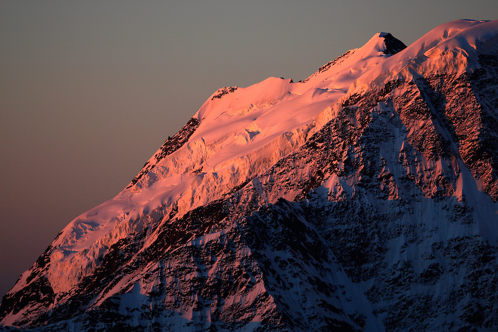 Russia, Caucasus, early morning, red light on the glacier on Mount Donguzorun (4468 m asl), seen from Elbrus.