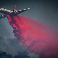 A DC10 jet air tanker drops fire retardant on The Holcomb Fire as it burns in the Holcomb Valley are of the San Bernardino National Forest near Big Bear, Tuesday, June 20, 2017. Firefighters are battling a wildland fire north of Baldwin Lake in the Big Bear Lake area had charred 950 acres, and was 10 % contained. (EricReed/For The Souther California Newspaper Group)