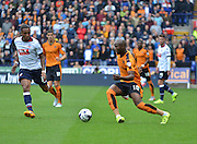 Benik Afobe on the break past Neil Danns during the Sky Bet Championship match between Bolton Wanderers and Wolverhampton Wanderers at the Macron Stadium, Bolton, England on 12 September 2015. Photo by Mark Pollitt.