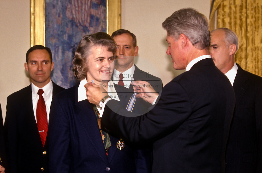 President Bill Clinton awards Dr. Shannon Lucid the Congressional Space Medal of Honor December 2, 1996 at the White House in Washington.