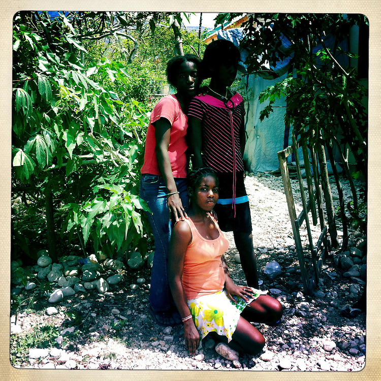 Girls pose for a picture at the Corail camp on Thursday, April 5, 2012 in Port-au-Prince, Haiti.