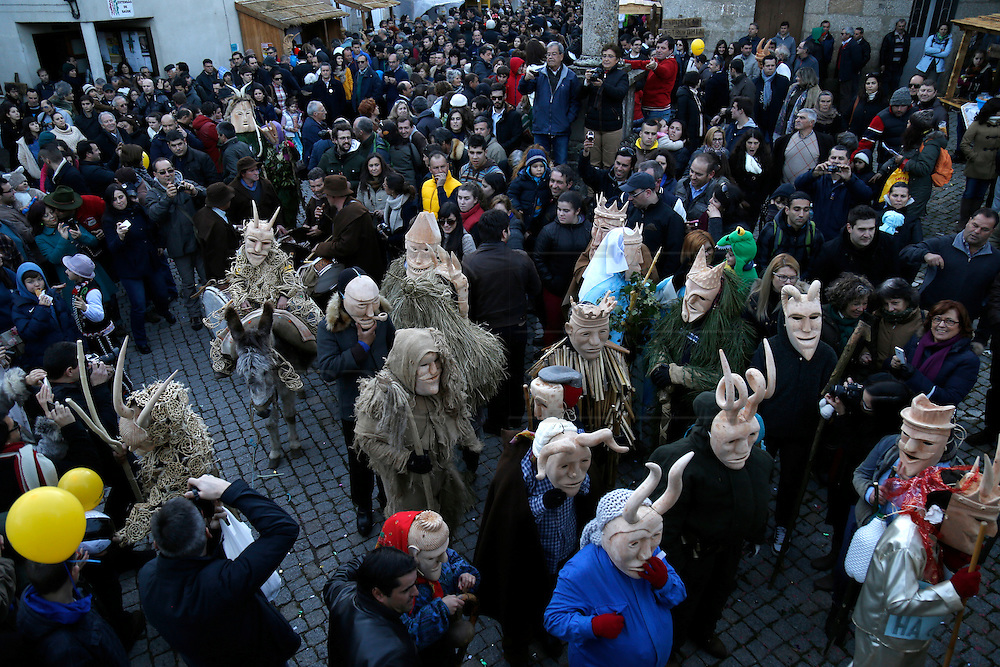 """Revellers with wooden masks and carnival garb mix with spectators during the traditional Celtic carnival """"Caretos"""" in the village of Lazarim, central Portugal on February 17, 2015. PAULO CUNHA /4SEE"""
