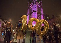 © Licensed to London News Pictures. 06/02/2018. Bristol, UK.  Women vote 100th anniversary; the University of Bristol Wills Memorial Building is lit with Suffragette colours of purple for the march in Bristol to celebrate the 100th anniversary of women getting the vote in the UK in 1918, following the campaign by the Suffragettes. Hundreds of women and some men marched down Park Street to College Green for a rally and entertainment on the evening of 06 February 2018.  Photo credit: Simon Chapman/LNP