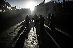60680015<br /> Buddhists circle the Jokhang Temple, a destination of pilgrimage, on the Porgor (or Barkhor) Street to offer prayers, in Lhasa, capital of southwest China s Tibet Autonomous Region, Nov. 6, 2013. Sacred temples in Lhasa, the Jokhang Temple for instance, receive more pilgrims in winter, a slack season for farming. Rolling prayer wheels, practising prostrations, or simply chanting Buddhist mantras, the pilgrims have various ways to fulfil their lifetime religious pursuits, Wednesday, 6th November 2013. Picture by  imago / i-Images<br /> UK ONLY