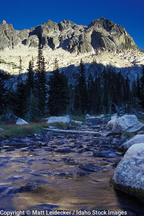 Idaho, Sawtooth Mountains, Cramer peak walls refelct light behind Cramer Creek.