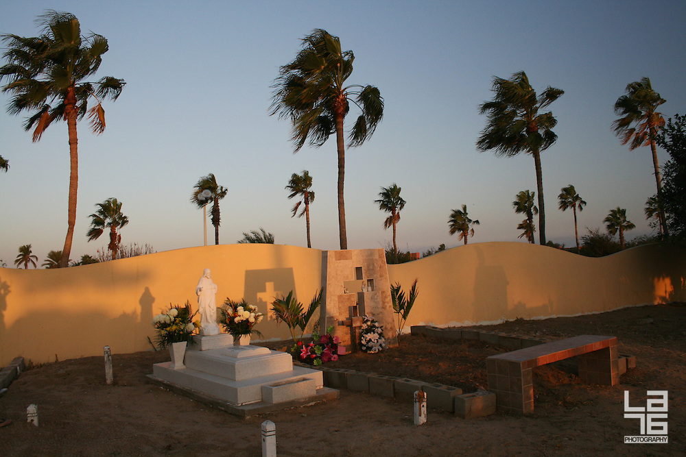 """Photographs were taken at a public cemetery during The Day of The Dead celebrations in San Jose del Cabo, Baja California Sur, Mexico.<br /> Day of the Dead, El Día de los Muertos, or All Souls' Day, is a holiday celebrated all over the world in honor of our beloved deceased. The holiday focuses on gatherings of family and friends to pray for and remember friends and family members who have died. <br /> In Mexico, El Día de los Muertos is actually a celebration of life. The Day of the Dead celebrations in Mexico can be traced back to the indigenous Olmec, Zapotec, Mixtec, Mexican or Aztec, Maya, P'urhépecha, and Totonac. Rituals celebrating the deaths of ancestors have been observed by these civilizations perhaps for as long as 2500-3000 years.<br /> In most regions of Mexico, November 1 honors children and infants, whereas deceased adults are honored on November 2 by taunting them in their grave. This is indicated by generally referring to November 1 mainly as """"Día de los Inocentes"""" (Day of the Innocents) but also as """"Día de los Angelitos"""" (Day of the Little Angels) and November 2 as """"Día de los Muertos"""" or """"Día de los Difuntos"""" (Day of the Dead). <br /> The Day of the Dead celebration occurs on the 2nd of November in connection with the Catholic holiday of All Saints' Day which occurs on Nov 1st and All Souls' Day which occurs on Nov 2nd. Traditions include building private altars honoring the deceased, using sugar skulls, marigolds, and the favorite foods and beverages of the departed, and visiting graves with these as gifts.<br /> Similar holidays are celebrated in many parts of the world; it's a public holiday (Dia de Finados) in Brazil, where many Brazilians celebrate by visiting cemeteries and churches. In Spain, there are festivals and parades, and at the end of the day, people gather at cemeteries and pray for their loved ones who have died. Similar observances occur elsewhere in Europe and in the Philippines, and similar celebrations appear in many Asian a"""