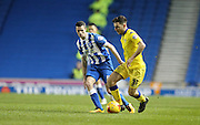 Leeds United defender, Lewie Coyle (31) gets away from Brighton winger, Jamie Murphy (15) during the Sky Bet Championship match between Brighton and Hove Albion and Leeds United at the American Express Community Stadium, Brighton and Hove, England on 29 February 2016.