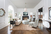 Traditional, white living room with hardwood floors and pocket doors.