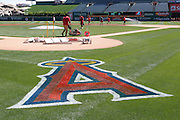 ANAHEIM, CA - JUNE 05:  Members of the grounds crew ready the infield before the Los Angeles Angels of Anaheim game against the New York Yankees on June 5, 2011 at Angel Stadium in Anaheim, California. The Yankees won the game 5-3. (Photo by Paul Spinelli/MLB Photos via Getty Images)