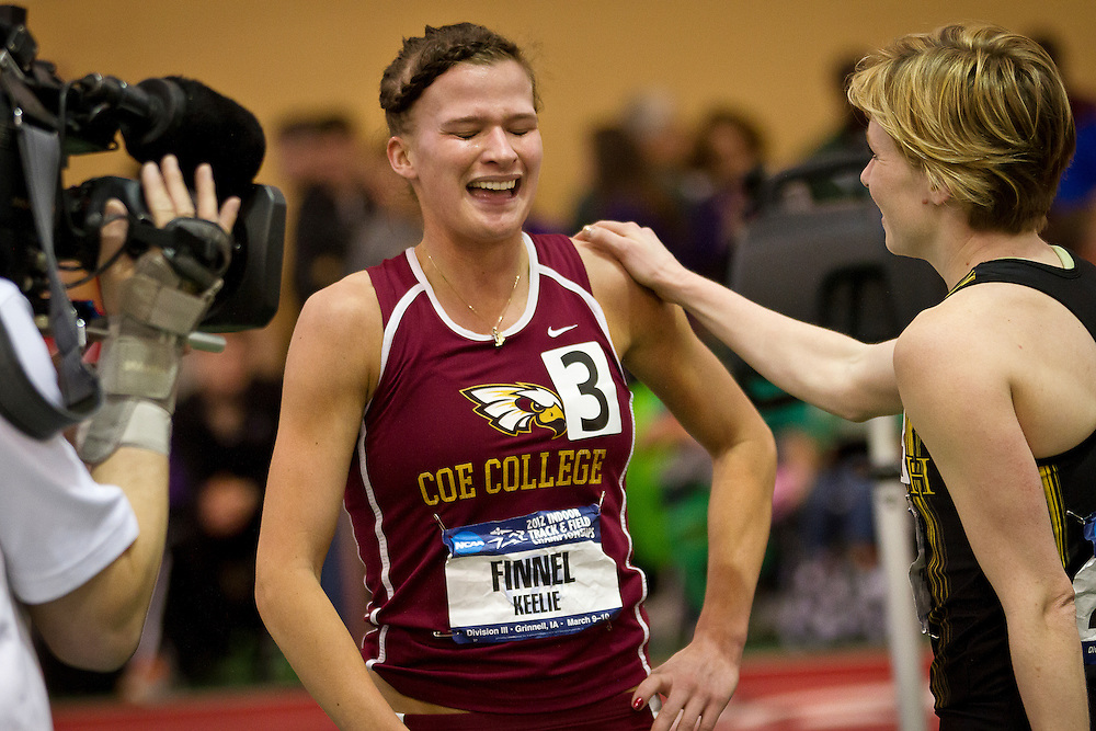 Coe College 800m runner Keelie Finnel is consoled by UW-Oshkosh's Christy Cazzola after a hard-fought final stretch between the two after the finals of the 800m on Saturday.