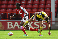 Mathieu Manset of Walsall looks to get past George Moncur of Colchester United during the Sky Bet League 1 match between Walsall and Colchester United at the Banks's Stadium, Walsall<br /> Picture by Richard Blaxall/Focus Images Ltd +44 7853 364624<br /> 06/09/2014