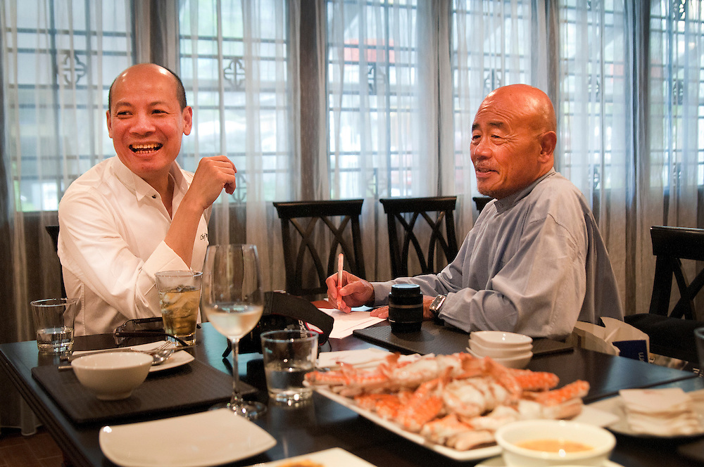 "Chef Pop (left) who runs Maison Chin with Ken Hom (right) during a interview for One Channel Asia TV at Maison Chin in Bangkok, Thailand. Ken Hom said:  ""Chef Pop (who runs Maison Chin) worked for me in London for 8 years.  He is sort of my Thai alter ego.  He understands what we are trying to do and we are in touch all the time.   We're sort of like twin brothers! (laughs)"""