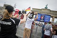 Berlin, Germany - 12.06.2016 <br /> <br /> European Football Championship 2016 fan mile at the Brandenburg Gate in Berlin. Football fans wait at the public viewing on the Stra&szlig;e des 17. Juni waiting for the beginning of the Euro-2016 football match between Germany and Ukraine .<br /> <br /> Fanmeile am Brandenburger Tor zur Fussball-Europameisterschaft 2016. Fussballfans warten beim Public Viewing auf der Stra&szlig;e des 17. Juni das Euro-2016 auf den Start des Fussballspiel zwischen Deutschland und der Ukraine.<br /> <br /> Photo: Bjoern Kietzmann