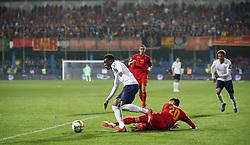 England's Callum Hudson-Odoi runs past Montenegro's Mirko Ivanic (20)