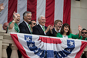 Vice President Mike Pence, center, and his wife Karen Pence, right, join Savannah Mayor Eddie DeLoach, center right, and his wife Cynthia DeLoach, left, watch the St. Patrick's Day parade from the balcony at City Hall, Saturday, March 17, 2018, in Savannah, Ga. (AP Photo/Stephen B. Morton)