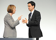 © Licensed to London News Pictures. 29/09/2011. LONDON, UK. Harriet Harman MP, Deputy Leader of the Labour Party talks to Ed Miliband, Leader of the Labour Party at The Labour Party Conference in Liverpool today (29/09/11). Photo credit:  Stephen Simpson/LNP