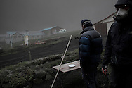 Environmental engineers from Reykjavik University visit a farm in rural area under the plume to monitor the consequence of a thick fall of the fallout from Iceland's Eyjafjoell volcano. They also scoop samples of ashes for study. Darkness settles under an ash cloud  spewed by Iceland's Eyjafjallajokull volcano that blacked out visibility under the plume. Picture taken in full day light during the afternoon.13 May 2010.<br />