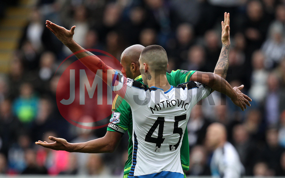 Aleksandar Mitrovic of Newcastle United and Younes Kaboul of Sunderland tangle - Mandatory byline: Robbie Stephenson/JMP - 20/03/2016 - FOOTBALL - ST James Park - Newcastle, England - Newcastle United v Sunderland - Barclays Premier League