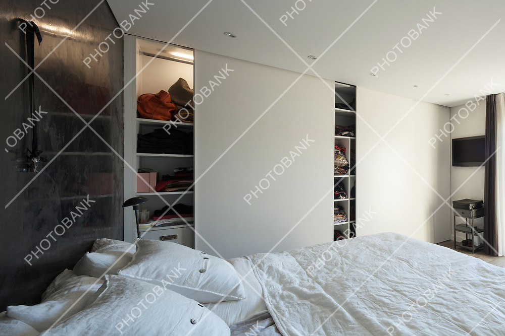 Interior of house, comfortable bedroom, closet wall