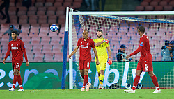 NAPLES, ITALY - Wednesday, October 3, 2018: Liverpool's Fabio Henrique Tavares 'Fabinho' and goalkeeper Alisson Becker look dejected as Napoli score an injury time winning goal during the UEFA Champions League Group C match between S.S.C. Napoli and Liverpool FC at Stadio San Paolo. Napoli won 1-0. (Pic by David Rawcliffe/Propaganda)