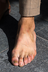 "© Licensed to London News Pictures . 30/06/2016 . Manchester , UK . RYAN STAVELEY , who appeared on the Channel 5 TV show "" Body Freak make me a perfect 10 "" , posing for photos in Manchester City Centre . He's been binding his feet to reduce his shoe size . Photo credit : Joel Goodman/LNP"