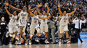 UConn starters; from left, Tiffany Hayes, Tina Charles, Maya Moore, Renee Montgomery and Kaili McLaren race onto the court to celebrate their NCAA national championship game win over Louisville Tues. April 7, 2009 at the Scottrade Center in St. Louis. The Huskies' 76-54 win gave the program their sixth national title and third undefeated season. (Sean D. Elliot/The Day)