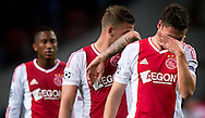 Ajax Amsterdam's  Derk Boerrigter (r) reacts after losing the match  during the UEFA Champions League Group D football match Ajax Amsterdam vs Real Madrid on October 3, 2012 AFP PHOTO/ ROBIN UTRECHT.