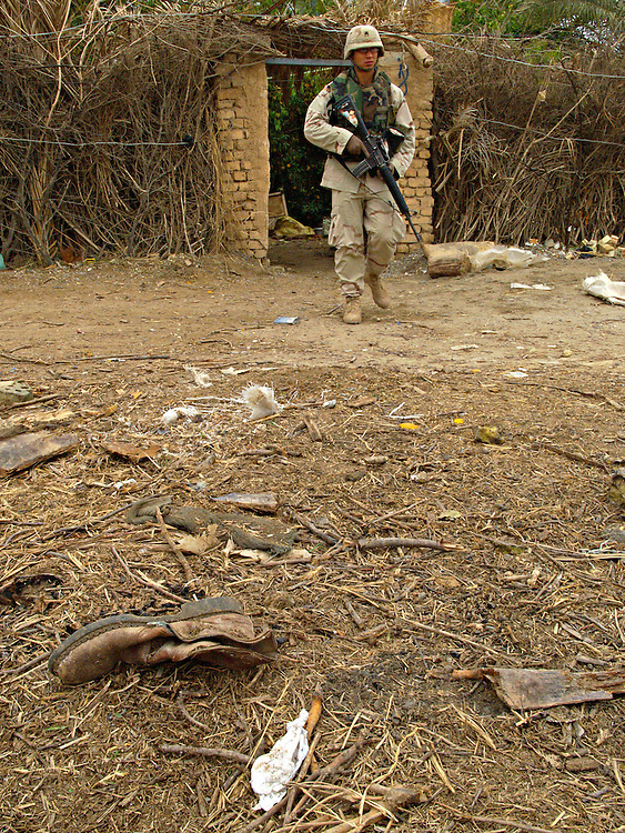 Dec15th 2003.ad Dawr, Iraq..Saddams hideout..A US soldier at the entrance of the farmhouse in which Saddam was captured near Tikrit.