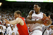 FAYETTEVILLE, AR - NOVEMBER 30:  Coty Clarke #4 of the Arkansas Razorbacks is fouled going to the basket by Brandon Triche #20 of the Syracuse Orangemen at Bud Walton Arena on November 30, 2012 in Fayetteville, Arkansas.  The Orangemen defeated the Razorbacks 91-82.  (Photo by Wesley Hitt/Getty Images) *** Local Caption *** Coty Clarke; Brandon Triche
