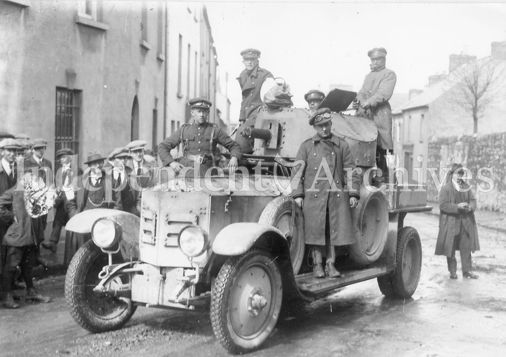 National Army troops and an armoured car during the Civil War at an unknown location (Part of the Independent Newspapers Ireland/NLI Collection)