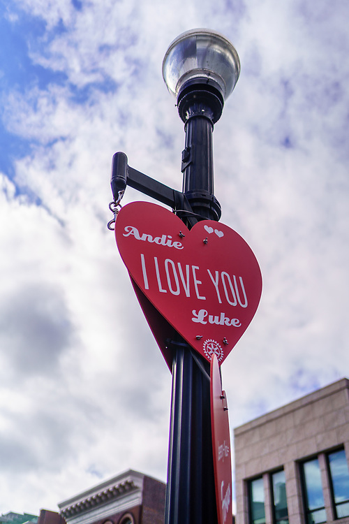 """Lancaster, PA, USA - February 14, 2020: The Penn Square Rotary Club """"Hearts  For Lancaster"""" campaign posts a personalized sign as an expression of affection on a lamppost downtown."""