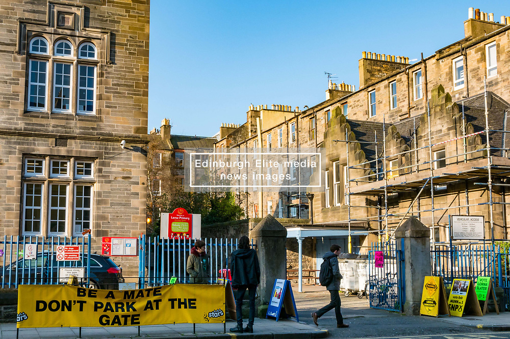 Leith, Edinburgh, Scotland, United Kingdom, 11 April 2019. Leith Walk Council By-Election:  One of the polling stations at Lorne Primary School, with SNP activist Shaun, and Scottish Green activist Jenny waiting to greet voters. The election is taking place as a result of the resignation of Councillor Marion Donaldson. The election fields 11 candidates, including the first ever candidate for the For Britain Movement in Scotland, Paul Stirling.  The For Britain Movement was founded by former UKIP leadership candidate Anne Marie Waters in March 2018.  <br /> Sally Anderson/ Edinburgh Elite Media