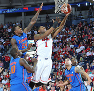 """Mississippi's Martavious Newby (1) shoots against Florida's Casey Prather (24) as Florida's Dorian Finney-Smith (10), Florida's Scottie Wilbekin (5), and Mississippi's Dwight Coleby (23) move in at the C.M. """"Tad"""" Smith Coliseum in Oxford, Miss. on Saturday, February 22, 2014. (AP Photo/Oxford Eagle, Bruce Newman)"""