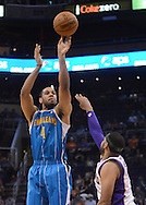 Apr 7, 2013; Phoenix, AZ, USA; New Orleans Hornets guard Xavier Henry (4) shoots the ball against the Phoenix Suns  forward Jared Dudley (3) in the second half at US Airways Center. The Hornets defeated the Suns 95-92. Mandatory Credit: Jennifer Stewart-USA TODAY Sports