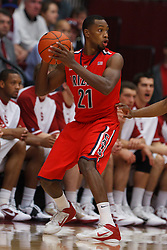 Feb 4, 2012; Stanford CA, USA;  Arizona Wildcats guard Kyle Fogg (21) holds the ball against the Stanford Cardinal during the first half at Maples Pavilion.  Arizona defeated Stanford 56-43. Mandatory Credit: Jason O. Watson-US PRESSWIRE