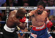 LAS VEGAS, NV - JUNE 09:  (R-L) Manny Pacquiao lands a right to the head of Timothy Bradley during their WBO welterweight title fight at MGM Grand Garden Arena on June 9, 2012 in Las Vegas, Nevada.  (Photo by Jeff Bottari/Getty Images)
