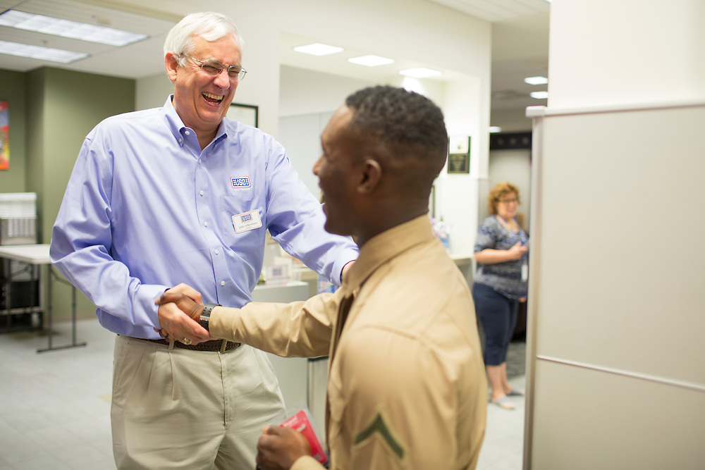 "John Falkenbury, 59, President of the North Carolina USO, greets Marines on their way to Camp Lejeune at Raleigh-Durham International Airport on Wednesday, July 15, 2015. This fall, AARP-North Carolina plans workshops for veterans on issues ranging from saving for retirement, family caregiving, financial literacy, job resources and planning the next steps in their life and career with ""Life Reimagined."""