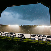 Rain pours down on the field during the game at Harvard Stadium on May 10, 2014 in Boston, Massachusetts. (Photo by Elan Kawesch)