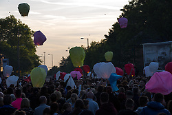 © Licensed to London News Pictures . 10/06/2015 . Manchester , UK . Dozens of lanterns and balloons are released . A vigil in memory of Dominic Doyle , near to where he was found fatally stabbed on Sunday morning (7th June 2015) , on Manchester Road in East Manchester . The Manchester Road (A57) is closed to traffic as hundreds gather to remember the 21 year old . Three people have been charged in connection with Doyle's murder and a 16 year old has been arrested on suspicion of murder . Photo credit : Joel Goodman/LNP