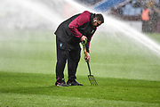 The groomsman gets wet as he forks the pitch during the EFL Sky Bet Championship match between Aston Villa and Nottingham Forest at Villa Park, Birmingham, England on 28 November 2018.