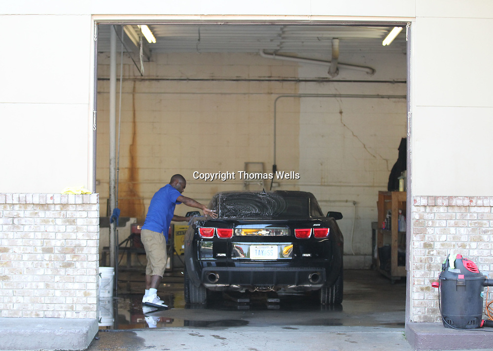 Traylor's Detail Shop on North Gloster uses three indoor bays to wahs and dry the cars before they move on to the next stop depending on what level of service the client gets.