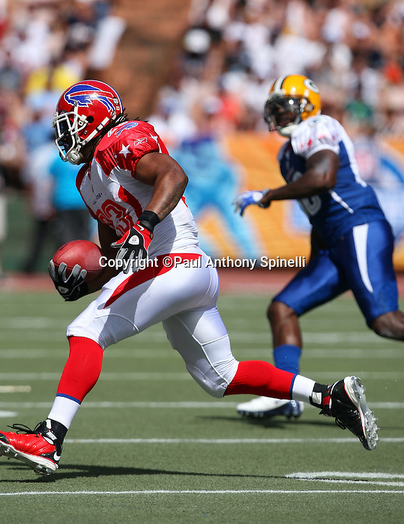 HONOLULU, HI - FEBRUARY 08: AFC All-Stars running back Marshawn Lynch #23 of the Buffalo Bills runs the ball against the NFC All-Stars in the 2009 NFL Pro Bowl at Aloha Stadium on February 8, 2009 in Honolulu, Hawaii. The NFC defeated the AFC 30-21. ©Paul Anthony Spinelli *** Local Caption *** Marshawn Lynch