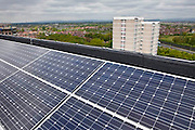 Photo Voltaic (PV) panels on the roof of Kentmere Court, a high-rise tower block in the Charlestown area of Manchester, run by Northwards Hoiusing.  Northwards Housing has gone far beyond government standards in converting their housing stock into energy-efficient homes, with no charge to tenants. Already over 70% of their 12,500 houses have been overhauled with external wall insulation, double glazed windows,  A-rated boilers, and even solar panels.  In 2010, Northwards Housing won an Ashden Award for its appraoch to sustainability.