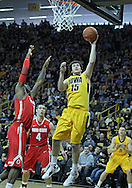January 07, 2011: Iowa Hawkeyes forward Zach McCabe (15) puts up a shot as Ohio State Buckeyes forward Deshaun Thomas (1) defends during the the NCAA basketball game between the Ohio State Buckeyes and the Iowa Hawkeyes at Carver-Hawkeye Arena in Iowa City, Iowa on Saturday, January 7, 2012.